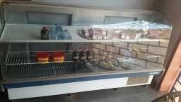Vendo freezer todo de vidro na frente semi novo