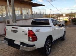 Toyota Hilux srx 50anos 20/20 diesel completo.Quero 70mil e assumir parcelas.