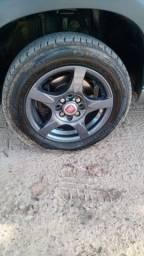 Vendo ou troco jogo de roda 14 com 4 pneu novo roda 8 furos pega em qualquer carro