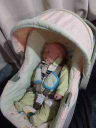 Bebê conforto da Infanti com base , está semi novo