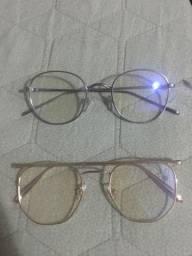 Duas armações de óculos grau novas a