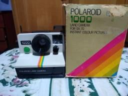 Máquina fotográfica Polaroid 100