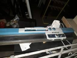 Máquina de tricô usada