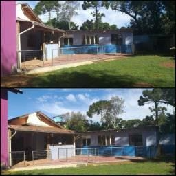 Casa<br>mais barracão e terreno grande alugoo
