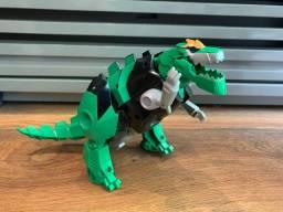 Boneco Transformers Robô  e dinossauro