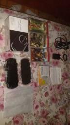 PSP zero com caixa e jogos