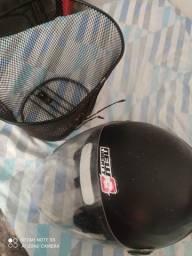 Vendo capacete New liberty 3 novo e cestinha para Bicicleta