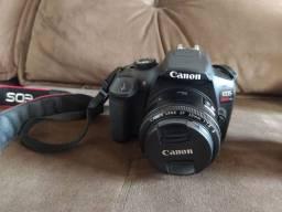 Camera Canon t6 semi nova com lente 18.55 mais 50mm flash youngnou