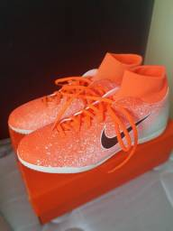 Chuteira Nike cano alto modelo vaporx 12 club ic