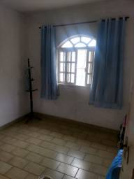 Alugo casa com três quartos dois banheiros sala cozinha área de serviço