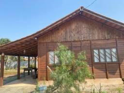 Vendo terreno com casa em madeira praia Ervino