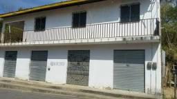 Casa em Palmácia com pontos comerciais em baixo e terreno com pequena casa em frente