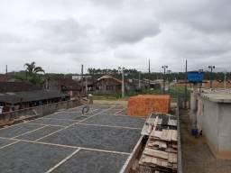 Belíssimo terreno, murado em 3 lados, com projeto e fundamento pronto para construir!