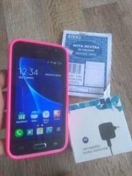 J1 2016 funcionando tudo normal capa silicone rosa, carregador turbo da Motorola e recibo