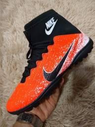 Chuteira Nike CR7 laranja com preto - Entrega Grátis