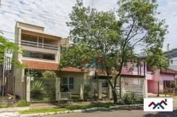 Casa com 6 dormitórios à venda, 423 m² por R$ 1.100.000,00 - Marechal Rondon - Canoas/RS