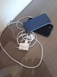Um celular Samsung com documentos  .lansamento  A01 32 gigas Novo na caixa