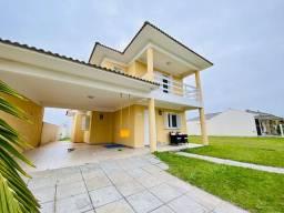 J - casa com dois terrenos, em Capão da Canoa.
