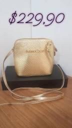 Bolsa dourada lateral em couro Nova