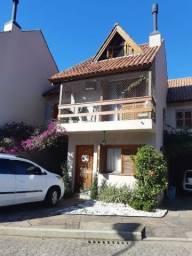 Casa à venda com 3 dormitórios em Guarujá, Porto alegre cod:MI12075