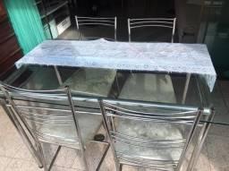 Mesa de inox com tampa de vidro e 4 cadeiras