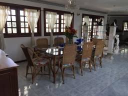 Mesa com tampo de vidro e 8 cadeiras
