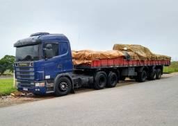 Conjunto Scania 124 400 com carreta grade baixa