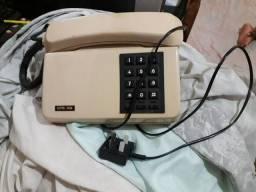 Telefone utrera  relíquia perfeito ainda funcionando tudo .