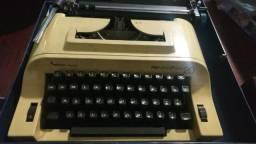Maquina de escrever + maleta toda funcionando