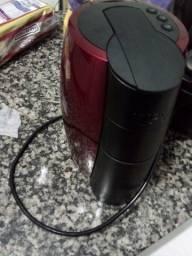 Vendo cafeiteira expresso nova  na caixa ou troco em uma geladeira usada