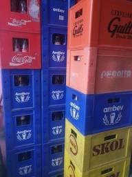 Caixa com vasilhame litrão e garrafa e diversas