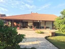 Casa térrea com 04 suítes em condomínio de alto padrão. JM 53