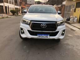 Hilux srx 2019 diesel aceito troca em outro carro aceito financiamento telefone *