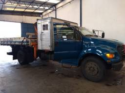 Ford F 12000 ano 2001 Munck MD 6503 com cabine suplementar