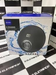 Caixa De Som X Zhang Bluetooth Portatil Mp3 Sd Fm Divido no cartão Fazemos entregas