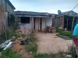 Casa com terreno em área verde