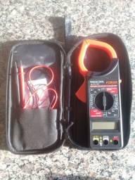 Alicate amperimetro e milímetro.