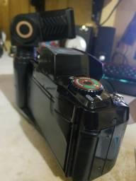 Câmera antiga Fulaica com estojo e flash