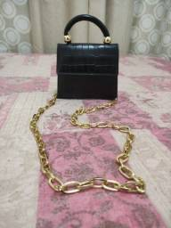 Bolsa com alsa de corrente