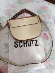Bolsa Shutz, original.