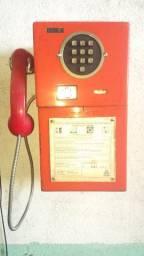 Telefone tipo orelhão de fichas