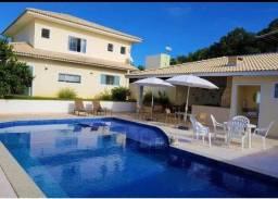 Vendo casa em Guarajuba com 4/4, suítes, piscina e quiosque!!