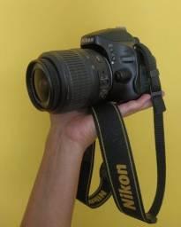 Nikon d5100 + lente + bolsa de transporte
