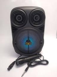 Caixinha de som com microfone