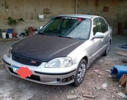 Honda Civic 2000.( troco por omega )