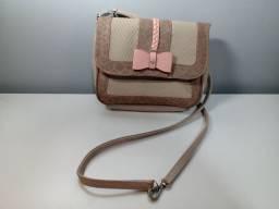 Bolsa transversal rosa com alça regulável