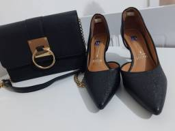 Bolsa e sapato usados