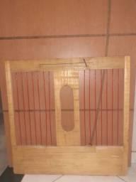 Porta de gaiola para galos de combate