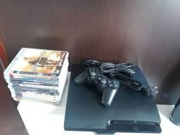 Vendo ps3 Slim  travado com 10 jogos mídia física.