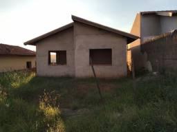 Terreno com construção não concluída